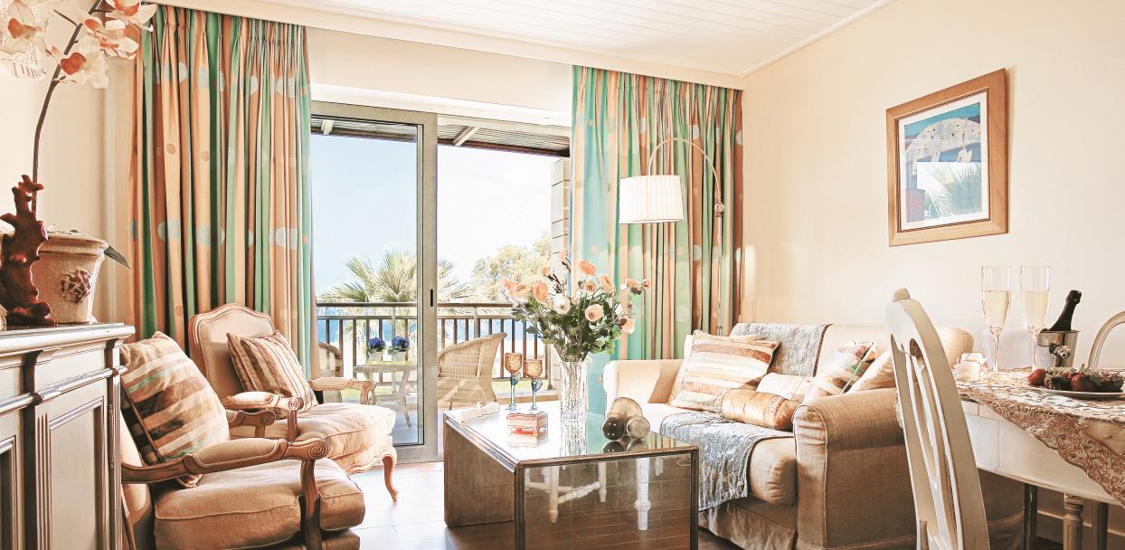 one-bedroom-bungalow-suite-beachfront-lounge-area-creta-palace-five-star-holidays