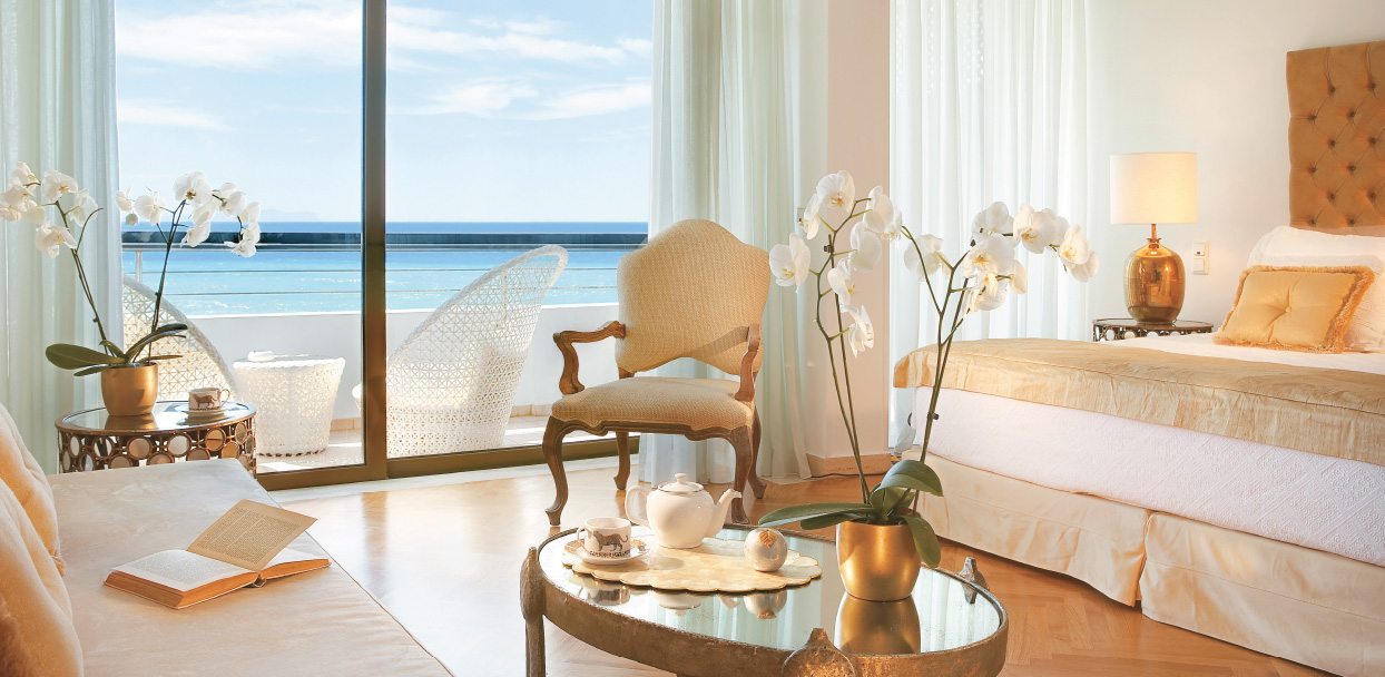 palace-guestroom-creta-palace-living-area-panoramic-sea-views