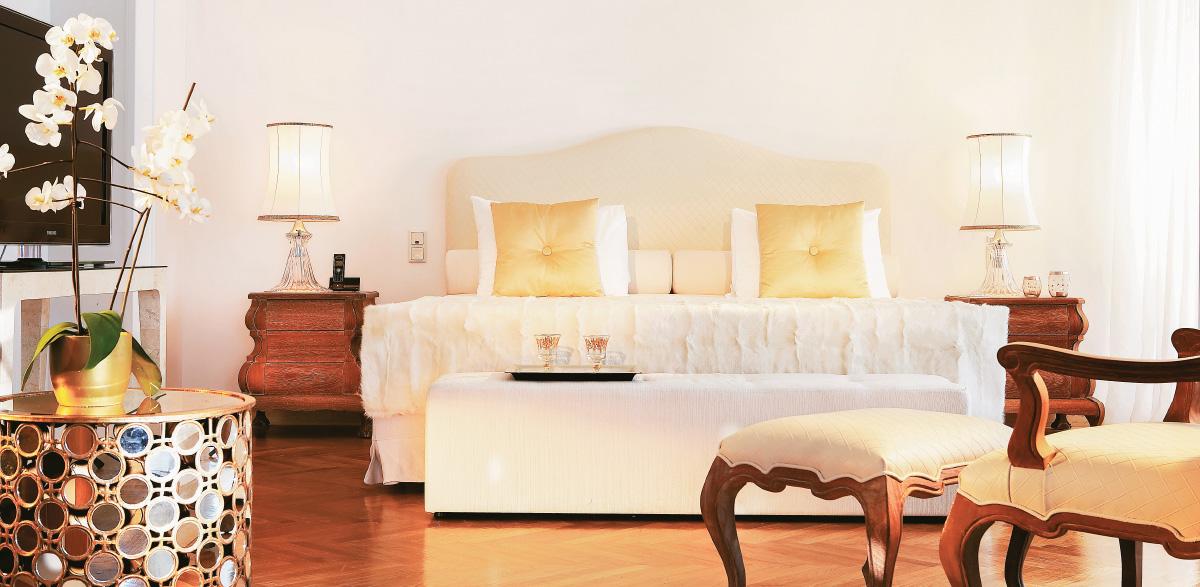 01-palace-luxury-suite-bedroom-and-living-area-creta-palace-resort-holidays