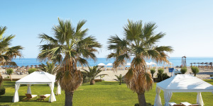 creta-palace-gardens-and-palms-in-luxury-resort-crete-greece