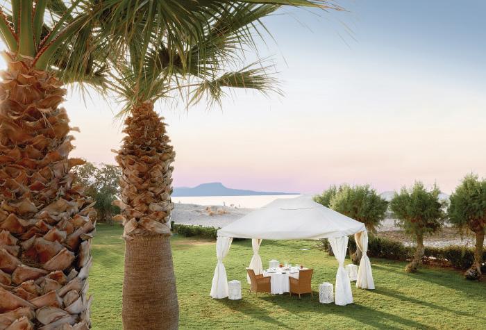 03-garden-wedding-ceremony-during-sunset-in-creta-palace-grecotel-greece